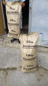 Продам древесный уголь в бум. мешках по 10 кг.